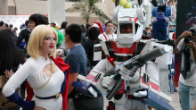 Cosplayers as Power Girl and a Gundam at Anime Expo 2015